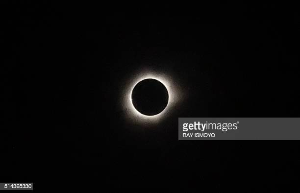TOPSHOT A total solar eclipse is pictured from the city of Ternate in Indonesia's Maluku Islands on March 9 2016 A total solar eclipse swept across...