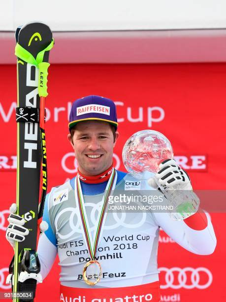 Total winner of the FIS Downhill World Cup Beat Feuz of Switzerland poses on the podium with his trophy after the Men's Downhill of the FIS World Cup...