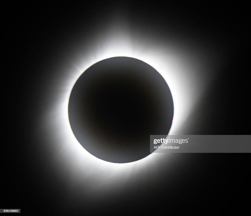 TOPSHOT - Totality of the Great American Eclipse on August 21, 2017, at Casper Collage Wyoming. The total eclipse lasted 2 min and 30 sec. Emotional sky-gazers stood transfixed across North America Monday as the Sun vanished behind the Moon in a rare total eclipse that swept the continent coast-to-coast for the first time in nearly a century. / AFP PHOTO / Gene Blevins