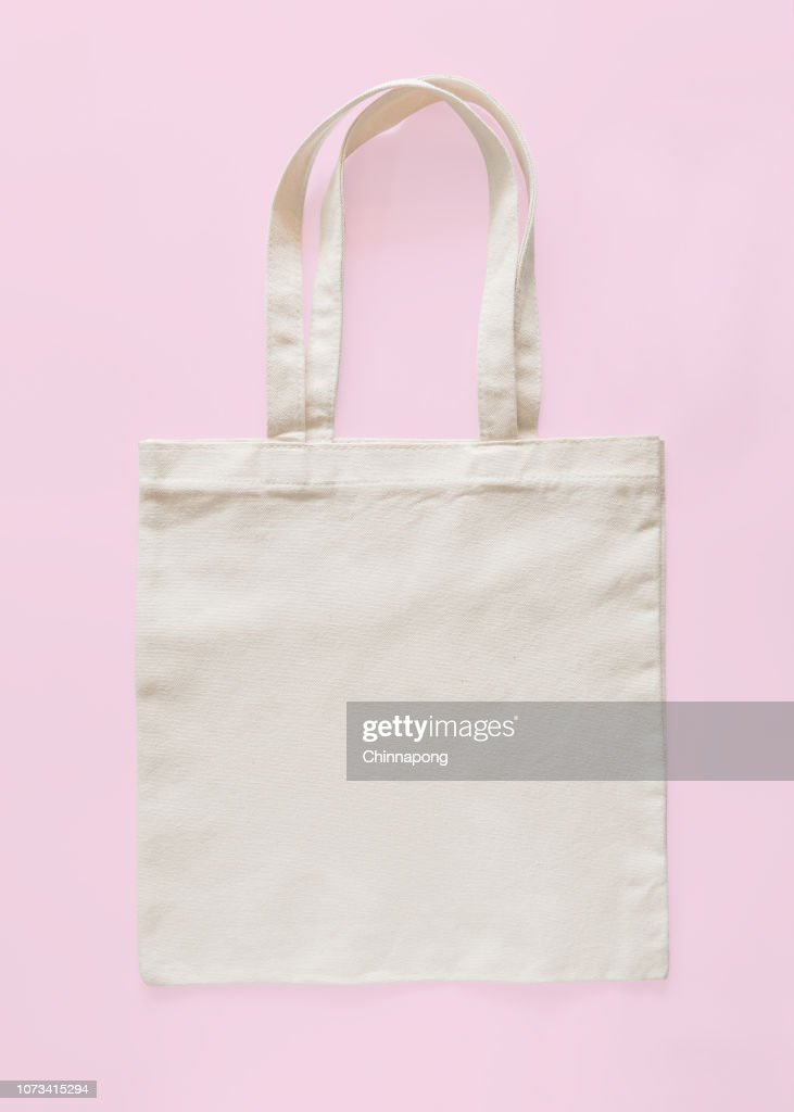 Tote bag canvas fabric cloth eco shopping sack mockup blank template isolated on pastel pink background (clipping path) : Stock Photo