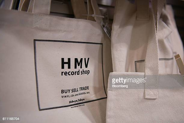 Tote bags are displayed for sale at the HMV Record Shop operated by Lawson HMV Entertainment Inc in the Shibuya district of Tokyo Japan on Wednesday...