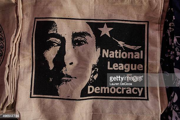 Tote bags with Aung Sun Suu Kyi's photo on display at the Bogyoke Market on November 13 2015 in Yangon Myanmar Aung San Suu Kyi's National League for...