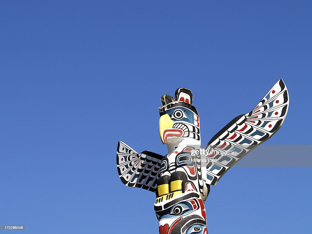 Totem against blue sky : Stock Photo