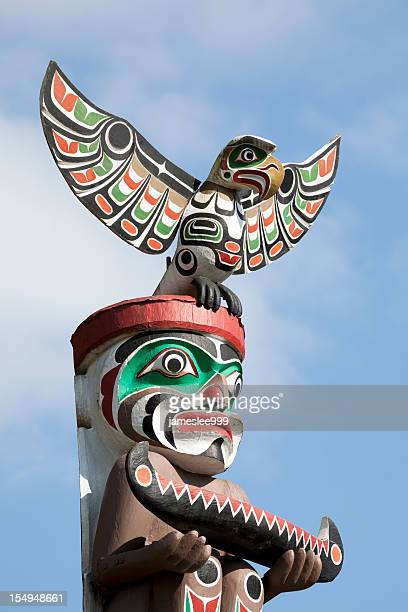 totem bird - totem pole stock photos and pictures