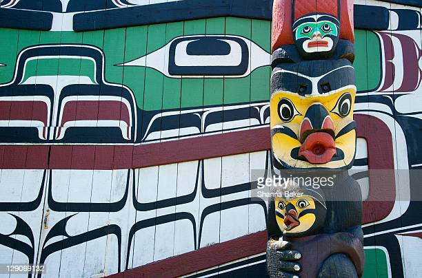 totem pole and native artwork - totem pole stock photos and pictures