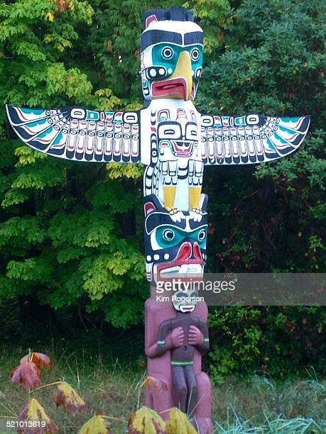 Totem pole of a thunderbird stands tall and at the ready in Stanley Park Vancouver BC Canada