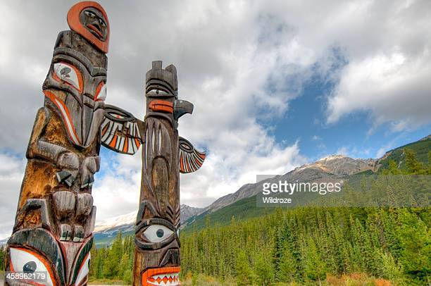 totem poles in banff national park - totem pole stock photos and pictures