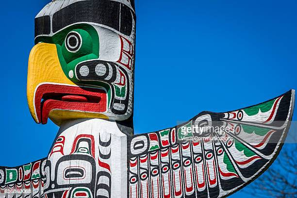 totem poles in stanley park, vancouver. - totem pole stock photos and pictures
