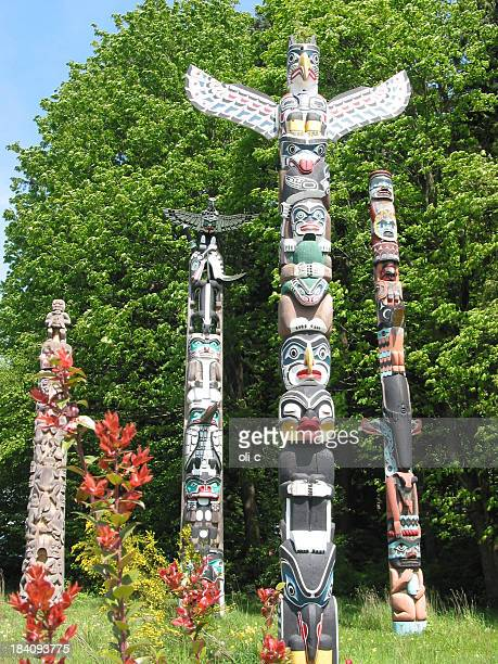 totem poles in vancouver - totem pole stock photos and pictures