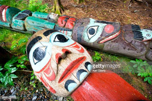 Totem poles lay on the ground at Totem Bight State Historical Park in Ketchikan, Alaska.