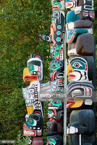 totem poles - stanley park stock photos and pictures