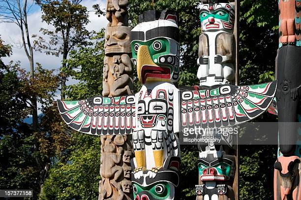 totem poles vancouver british columbia - totem pole stock photos and pictures