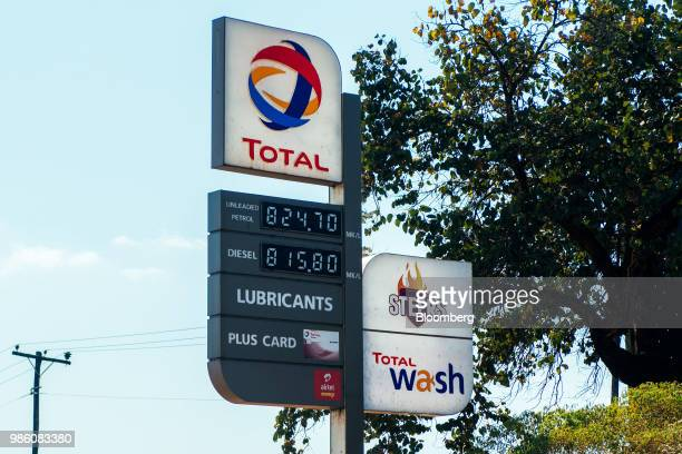 A totem sign displays prices for fuel at a Total SA gas filling station in Lilongwe Malawi on Tuesday June 26 2018 The diversification of the...
