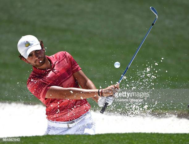 Toto Gana chips out of a sand trap along the 18th green during a practice round at Augusta National Golf Club Tuesday April 4 2017 in Augusta Ga