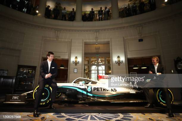 Toto Wolff, Team Principal & CEO of The Mercedes AMG-PETRONAS F1 Team and INEOS Founder and Chairman Sir Jim Ratcliffe pose for a photo with a...