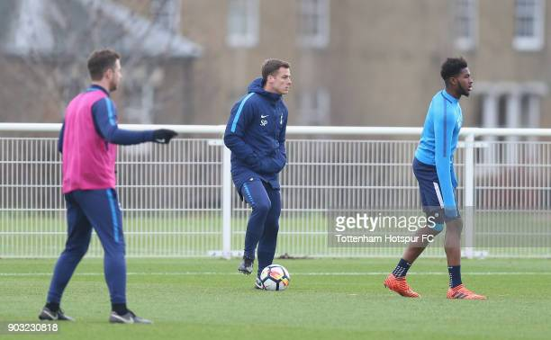 Tottenham coach Scott Parker watches his players warm up prior to the U18 Premier League match between Tottenham Hotspur and Liverpool at Tottenham...