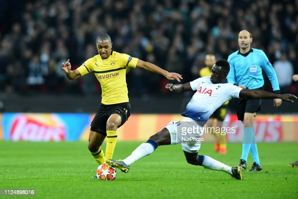 Tottenham defender Davinson Sanchez gets a boot in on Borussia Dortmund defender Abdou Diallo during the UEFA Champions League match between...