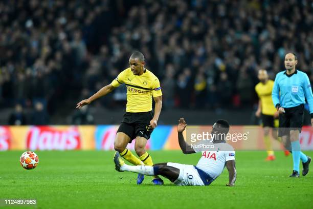 Tottenham defender Davinson Sanchez tackles Borussia Dortmund defender Abdou Diallo during the UEFA Champions League match between Tottenham Hotspur...