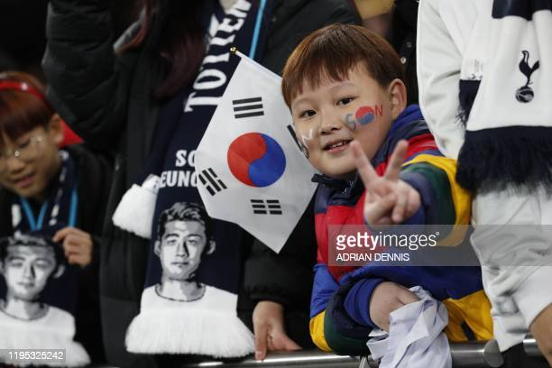 A Tottenham fan with his face painted with the name of Tottenham Hotspur's South Korean striker Son HeungMin is seen during the English Premier...