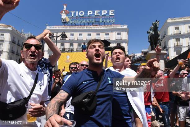 Tottenham fans are seen shouting slogans at the central square Liverpool and Tottenham fans gather at the squares in central Madrid ahead of the UEFA...