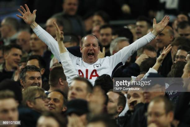 Tottenham fans celebrate their third goal during the UEFA Champions League Group H football match between Tottenham Hotspur and Real Madrid at...