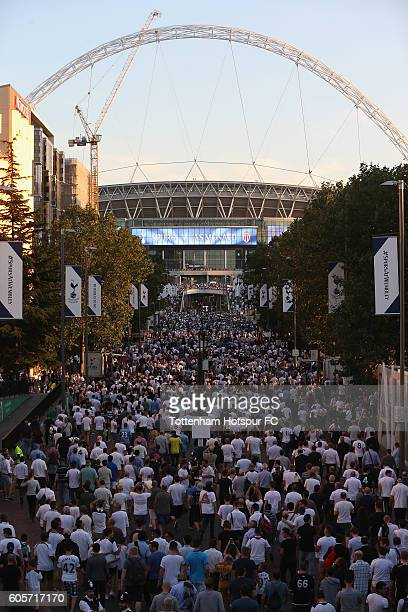 Tottenham fans make their way to Wembley prior to the UEFA Champions League match between Tottenham Hotspur FC and AS Monaco FC at Wembley Stadium on...