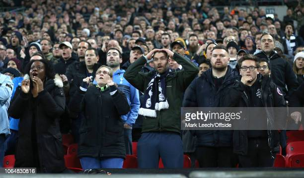 Tottenham fans watch with anxiety during the Premier League match between Tottenham Hotspur and Chelsea FC at Wembley Stadium on November 24 2018 in...