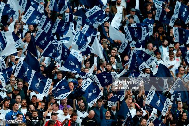 Tottenham fans wave their flags in the crowd before the UEFA Champions League semifinal first leg football match between Tottenham Hotspur and Ajax...
