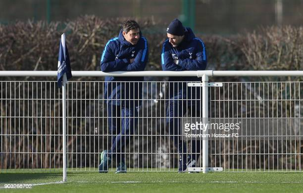 Tottenham first team manager Mauricio Pochettino and head coach Miguel D'Agostino during the U18 Premier League match between Tottenham Hotspur and...