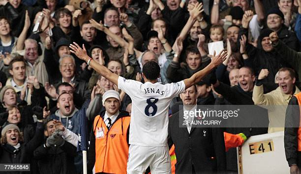 Tottenham footballer Jermaine Jenas gestures to the crowd after scoring in the first half against Wigan during a Premiership football match at the...