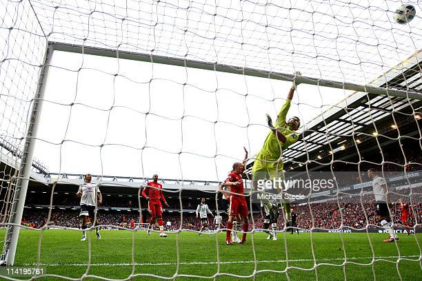 Tottenham goalkeeper Carlo Cudicini tips the ball over his crossbar during the Barclays Premier League match between Liverpool and Tottenham Hotspur...