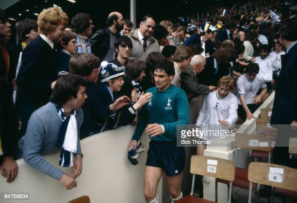 Tottenham goalkeeper Milija Aleksic walks down the steps from the Royal Box followed by Steve Archibald after the FA Cup Final against Manchester...