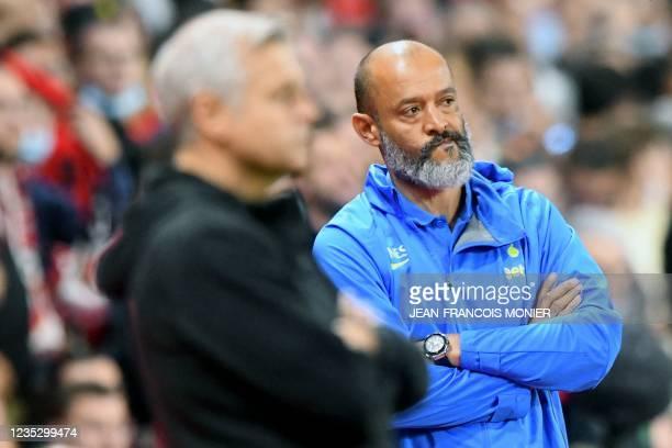 Tottenham head coach Nuno Espirito Santo reacts next to Rennes' French head coach Bruno Genesio during the UEFA Europa Conference League Group G...