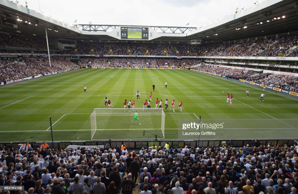 Tottenham Hotspur and Manchester United players line up as Christian Eriksen of Tottenham Hotspur crosses the ball for Harry Kane to score their second goal during the Premier League match between Tottenham Hotspur and Manchester United at White Hart Lane on May 14, 2017 in London, England. Tottenham Hotspur are playing their last ever home match at White Hart Lane after their 118 year stay at the stadium. Spurs will play at Wembley Stadium next season with a move to a newly built stadium for the 2018-19 campaign.