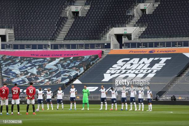 Tottenham Hotspur and Manchester United players observe a 2 minute silence in memory of HRH Prince Phillip Duke of Edinburgh during the Premier...