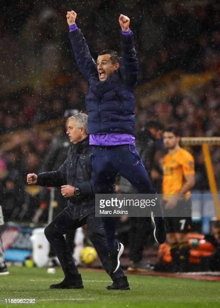 Tottenham Hotspur assistant coach Joao Sacramento celebrates the late winning goal alongside Jose Mourinho during the Premier League match between...