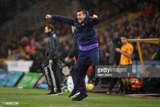 Tottenham Hotspur assistant coach Joao Sacramento celebrates the late winning goal during the Premier League match between Wolverhampton Wanderers...