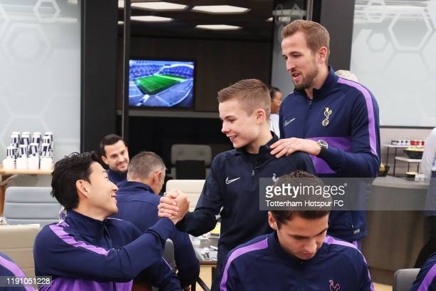 Tottenham Hotspur ball boy is greeted by HeungMin Son and Harry Kane of Tottenham Hotspur after being invited to the team lunch by Jose Mourinho...