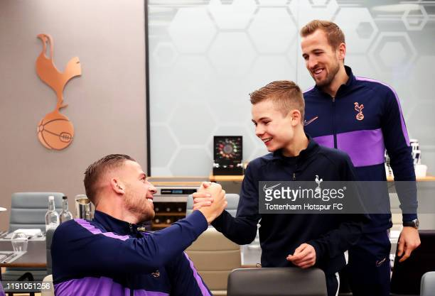 Tottenham Hotspur ball boy is greeted by Toby Alderweireld and Harry Kane of Tottenham Hotspur after being invited to the team lunch by Jose Mourinho...