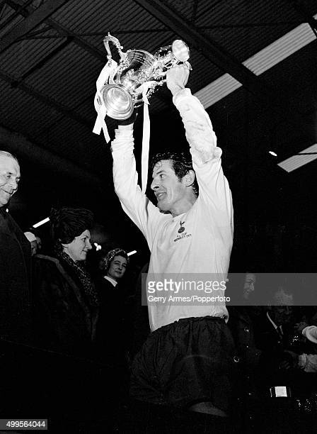 Tottenham Hotspur captain Alan Mullery holding the trophy aloft after the presentaion ceremony in the Royal Box following the League Cup Final...