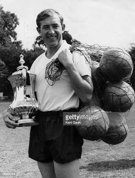 Tottenham Hotspur captain Danny Blanchflower holds the FA cup and a bag of balls Original Publication People Disc HC0491