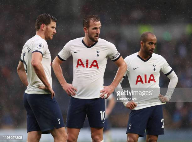 Tottenham Hotspur Captain Harry Kane waits with teammates Jan Vertonghen and Lucas Moura for the second half during the Premier League match between...