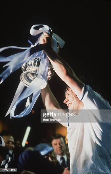 Tottenham Hotspur captain Steve Perryman lifts the trophy after beating Manchester City 32 in the FA Cup Final replay at Wembley Stadium London 14th...