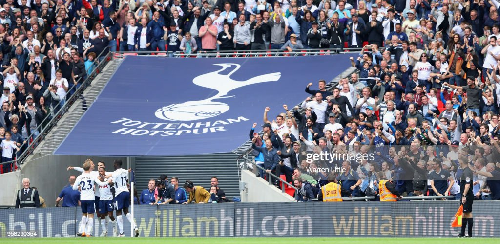Tottenham Hotspur celebrate their fourth goal scored by Erik Lamela during the Premier League match between Tottenham Hotspur and Leicester City at Wembley Stadium on May 13, 2018 in London, England.