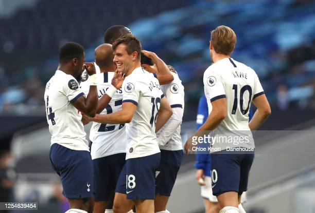 Tottenham Hotspur celebrate their teams first goal which was an own goal scored by Michael Keane of Everton during the Premier League match between...