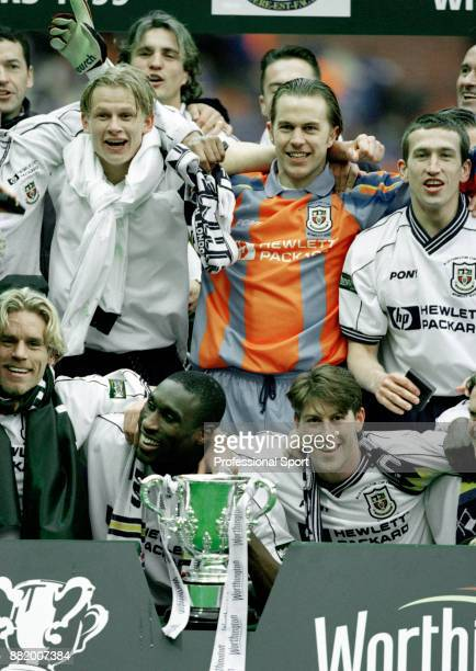 Tottenham Hotspur celebrate with the League Cup after beating Leicester City in the Worthington League Cup Final at Wembley Stadium on March 21 1999...