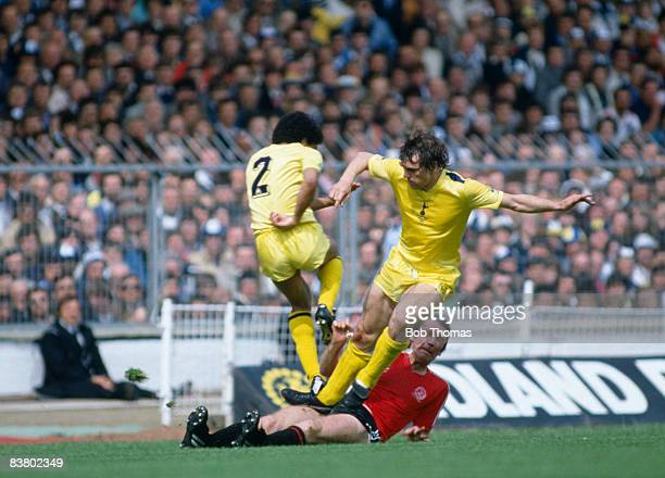 Tottenham Hotspur defenders Chris Hughton and Graham Roberts clash with Queens Park Rangers' Tony Currie during the FA Cup Final at Wembley 22nd May...