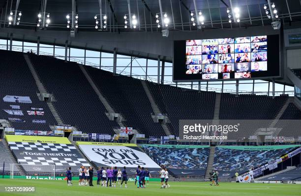 Tottenham Hotspur do a lap of honor in front of fans on the big screen after the Premier League match between Tottenham Hotspur and Leicester City at...