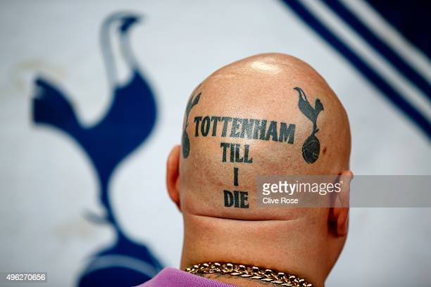 Tottenham Hotspur fan displays his tattoo prior to the Barclays Premier League match between Arsenal and Tottenham Hotspur at the Emirates Stadium on...