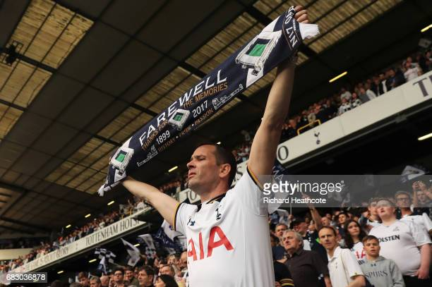 Tottenham Hotspur fan looks on during the closing ceremony after the Premier League match between Tottenham Hotspur and Manchester United at White...